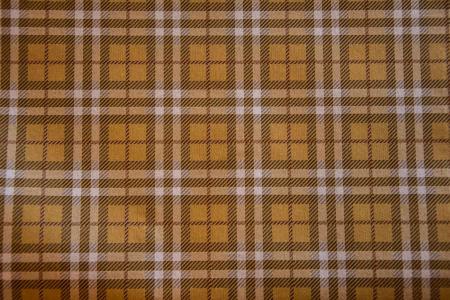 Gulbrun skotskternet papirbordløber