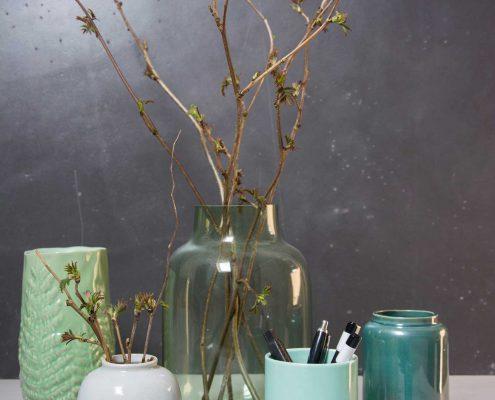 Samling af grønne vaser