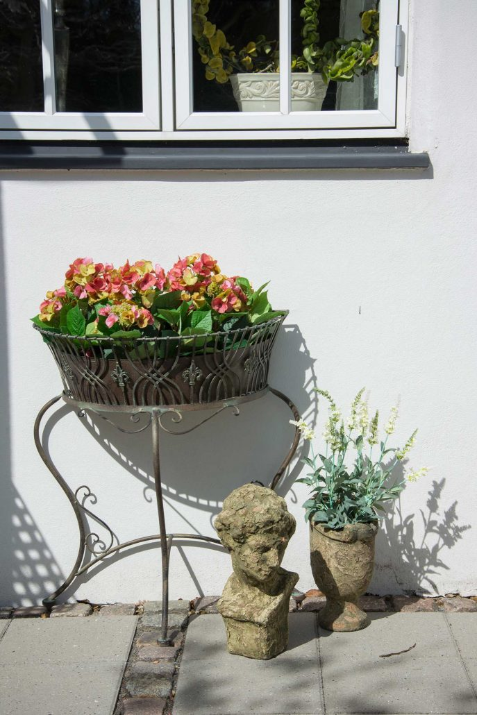 Blomsteropsats i jern til havedekoration