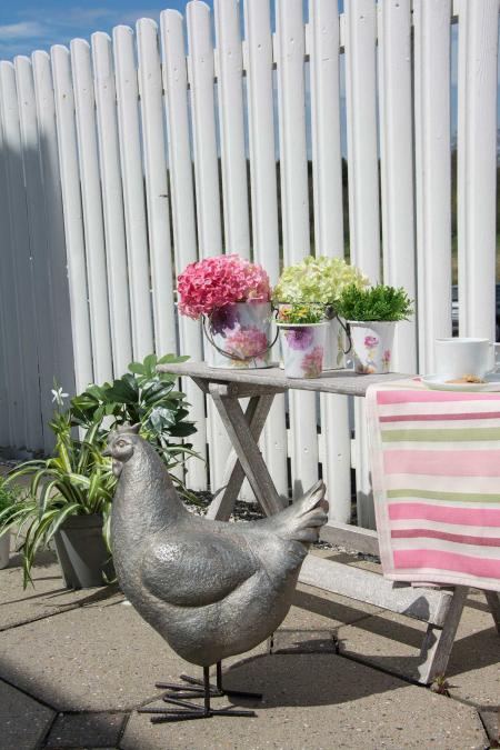 Indretning af terrassen med pyntegenstande