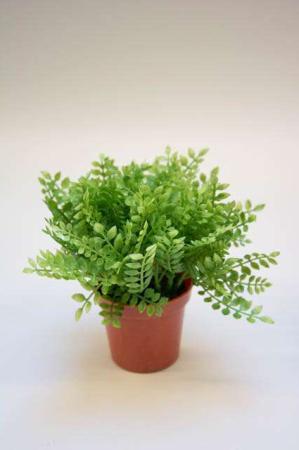 Kunstig grøn plante i potte