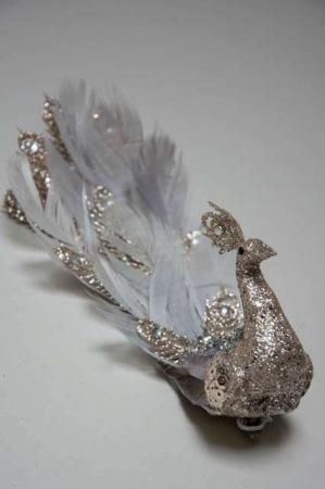 Sølvfarvet påfugl på klips