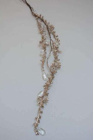 Guld glimmer gren med perler