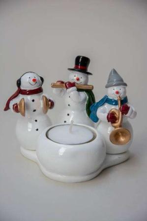 Harvesttime julestage til fyrfadslys med snemænd