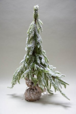 Kunstigt juletræ med sne i sæk