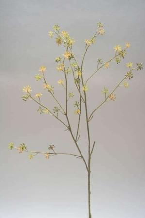 Kvist med gule blomster. Kunstig blomsterkvist