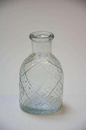 Lille flaske af glas til stearinlys. Lysestage til korte lys