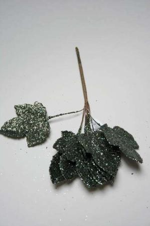 Dekorationsblad med grøn glimmer. Grønt glimmerblad til dekoration. Dekomateriale med glimmer.