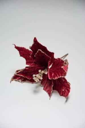 Rød julestjerne med glimmer. Kunstig julestjerne til dekoration. Juledeko med glimmer. Dekorationsmateriale til juledekoration.
