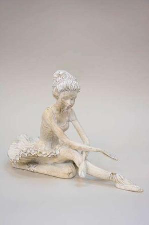 Siddende ballerina. Balletpige. Ballerina i antiklook