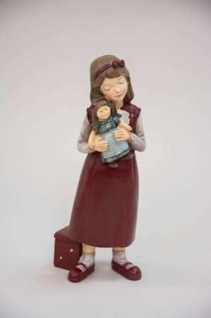 Julefigur af pige med dukke
