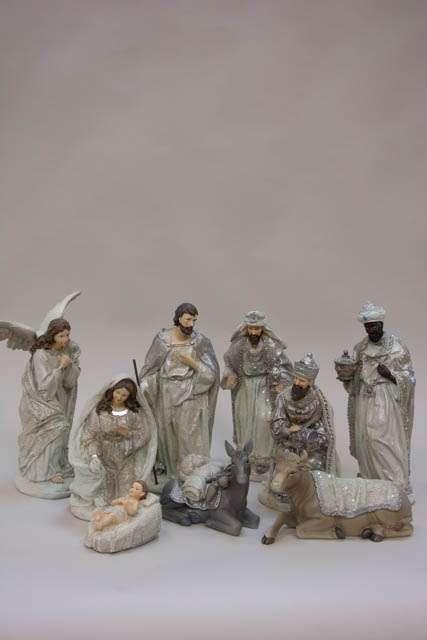Sølv krybbespil med jesusbarnet i krybben