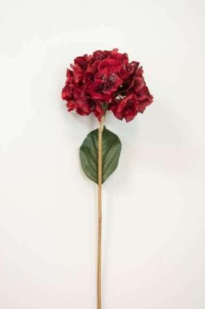 Kunstig rød blomst med glimmer