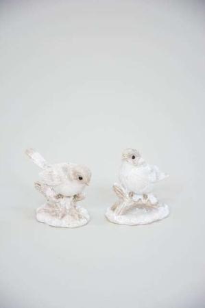 Små pyntefigurer af hvide fugle