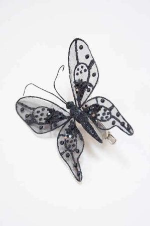 Sort sommerfugl på clips -